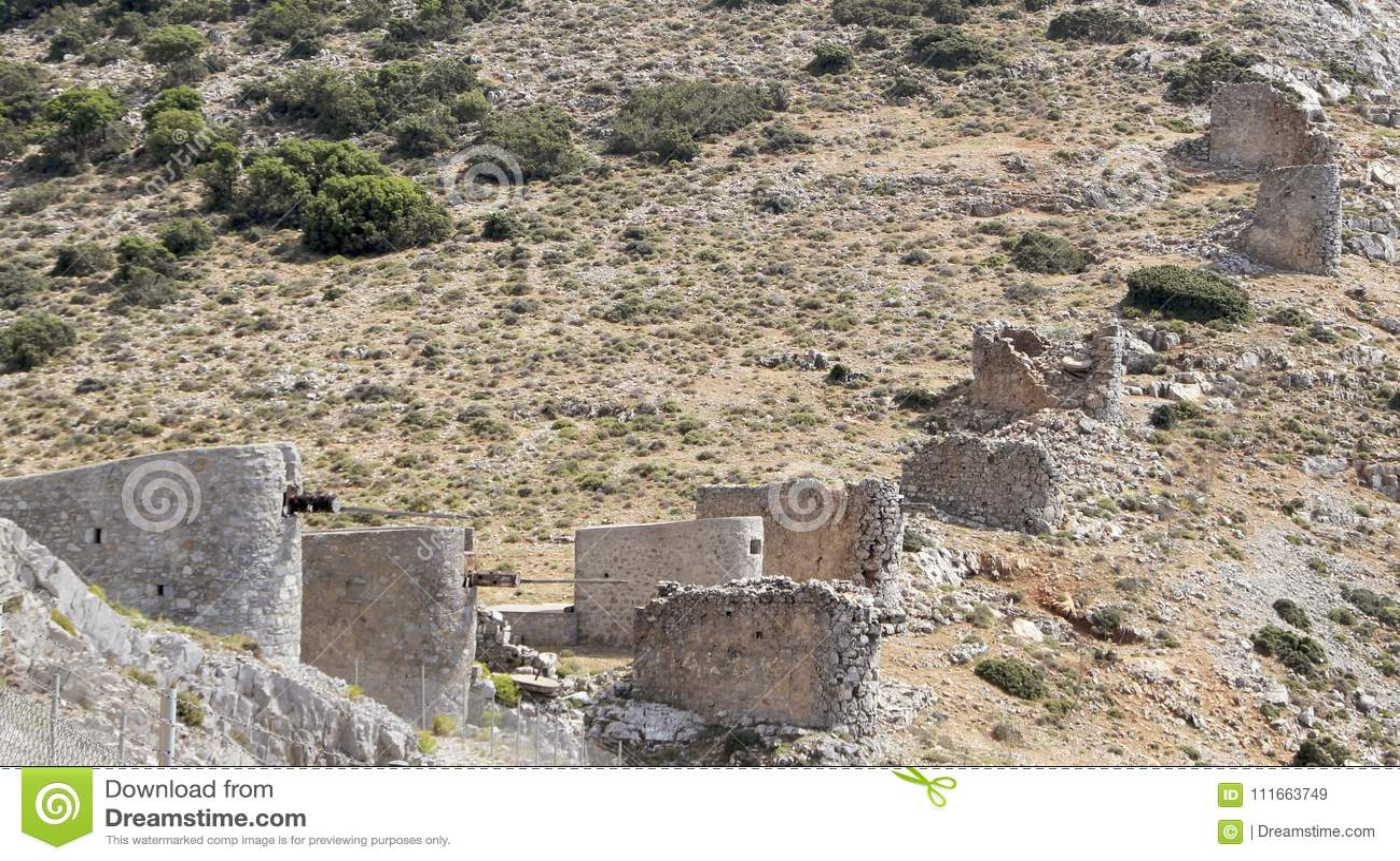 Ruins of ancient Venetian windmills built in 15th century, Lassithi Plateau, Crete, Greece