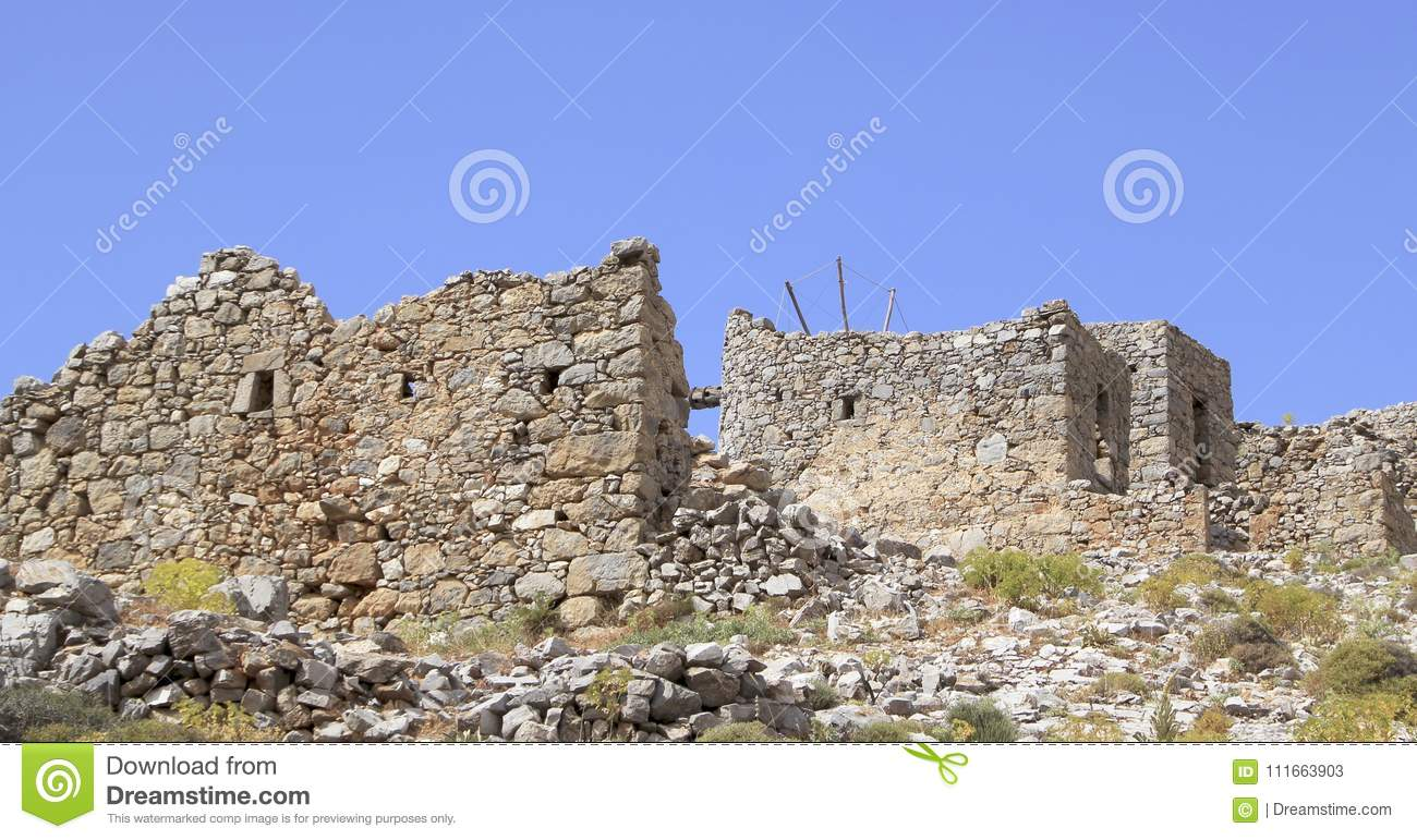 Ruins of ancient Venetian windmills built in 15th century, Lassithi Plateau, Crete, Greece