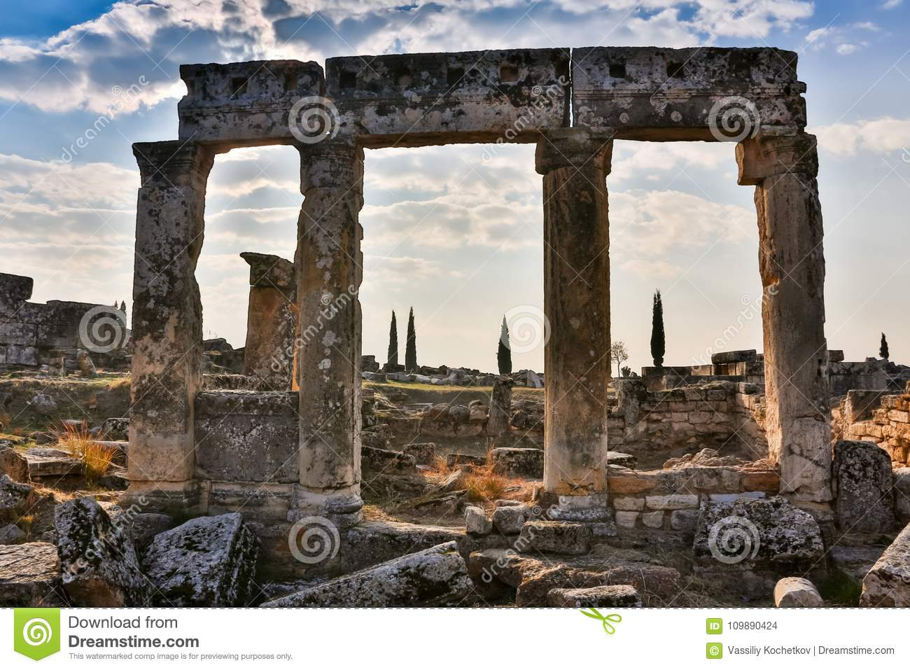 Ruins of Appollo temple with fortress at back in ancient Corinth, Peloponnese, Greece