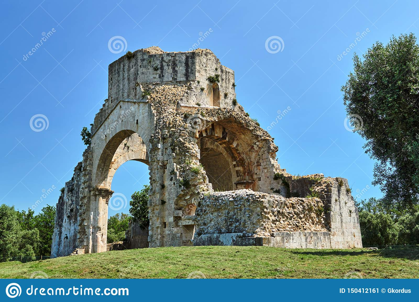 Ruins of a medieval stone church next to the town of Magliano