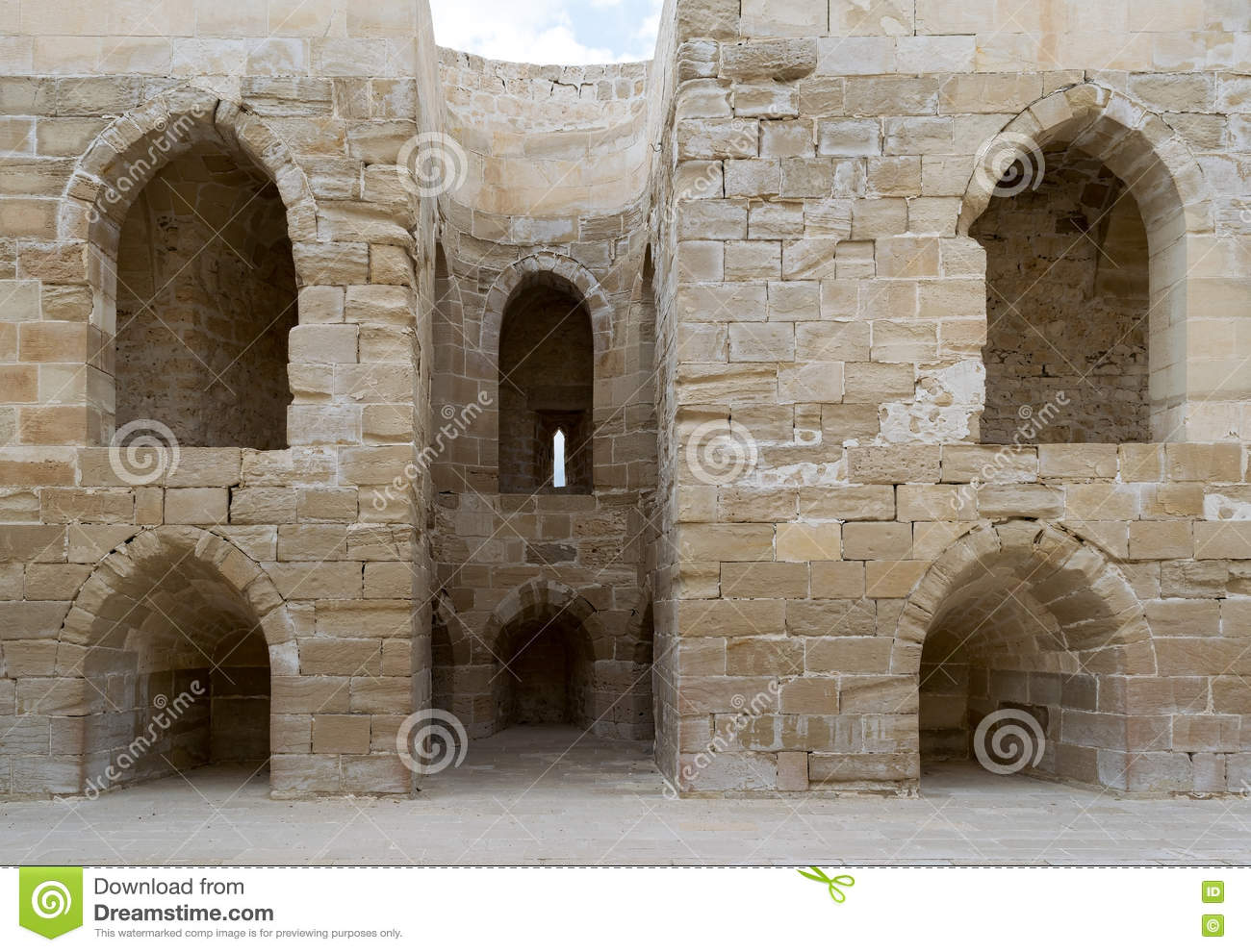 Ruins of old wall with arched cavities