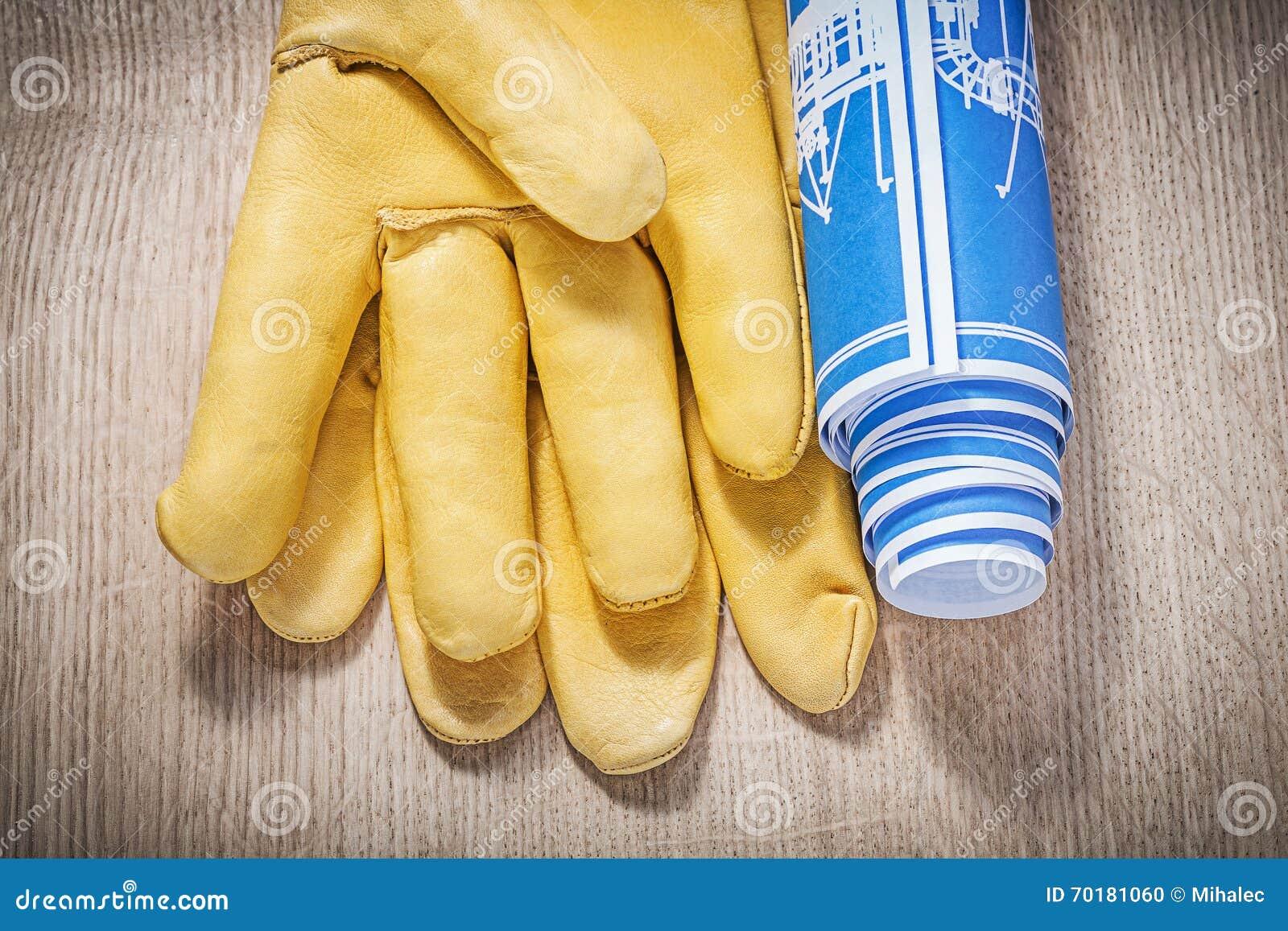 Rullande blåa teknikteckningar för säkerhet handskar på träbräde c