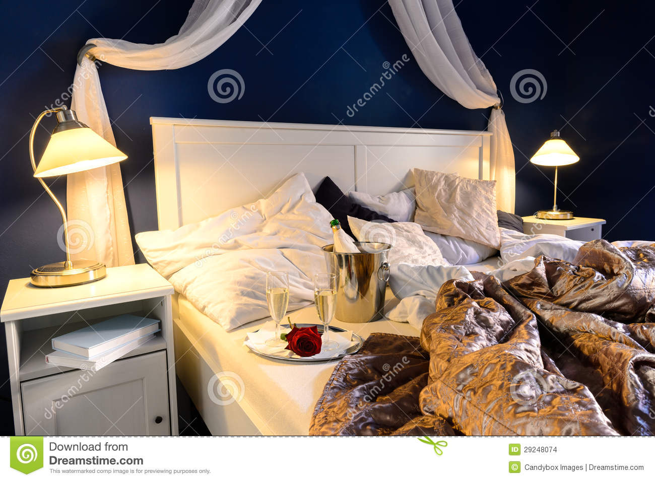 Rumpled sheets hotel bedroom romantic night stock photo for Night bed room romance