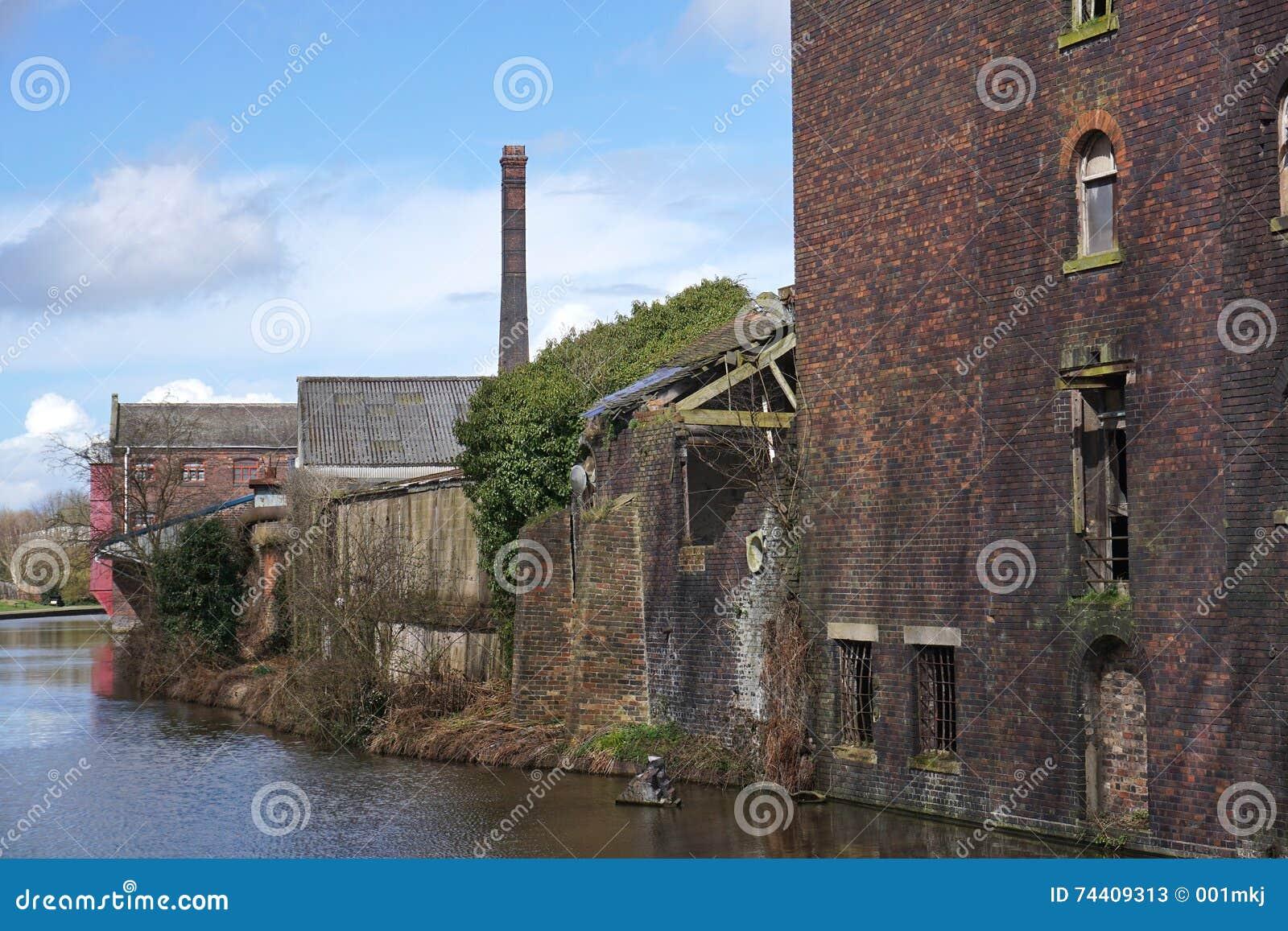 Rundown Building Decay Stock Photos Rundown: Run Down Industrial Buildings Alongside A Canal Stock