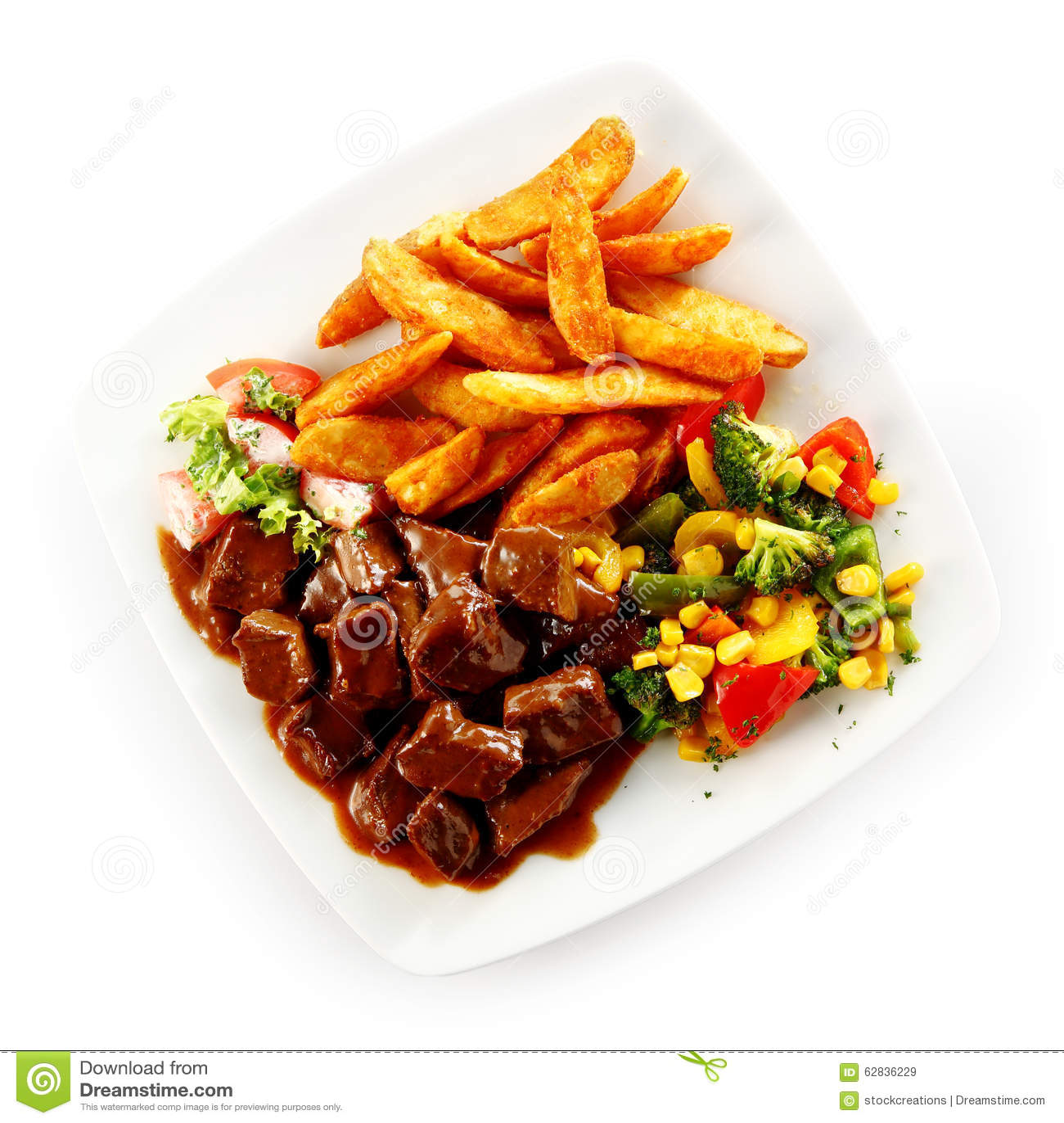 Rundvleeshutspot met gemengde groenten en spaanders stock foto afbeelding 62836229 - Hoek maaltijd ...
