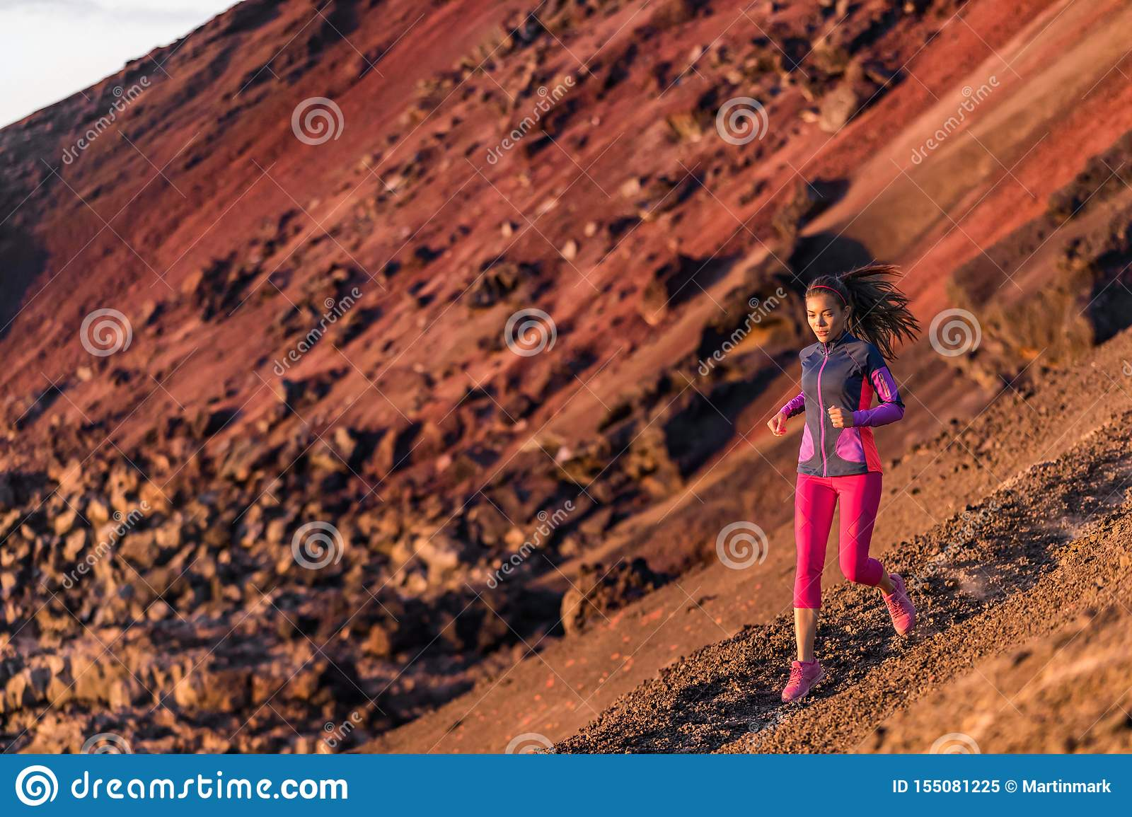 Runner athlete running on mountain trail. Young woman ultra run athlete running fitness workout. Healthy and active lifestyle,