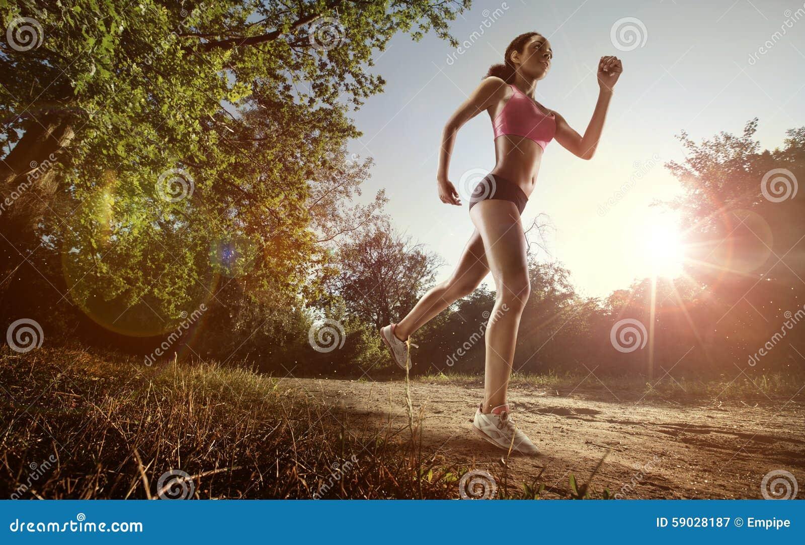 Runner athlete running at park.