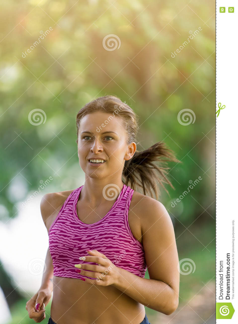 Runner athlete running at park. woman fitness jogging workout wellness concept.