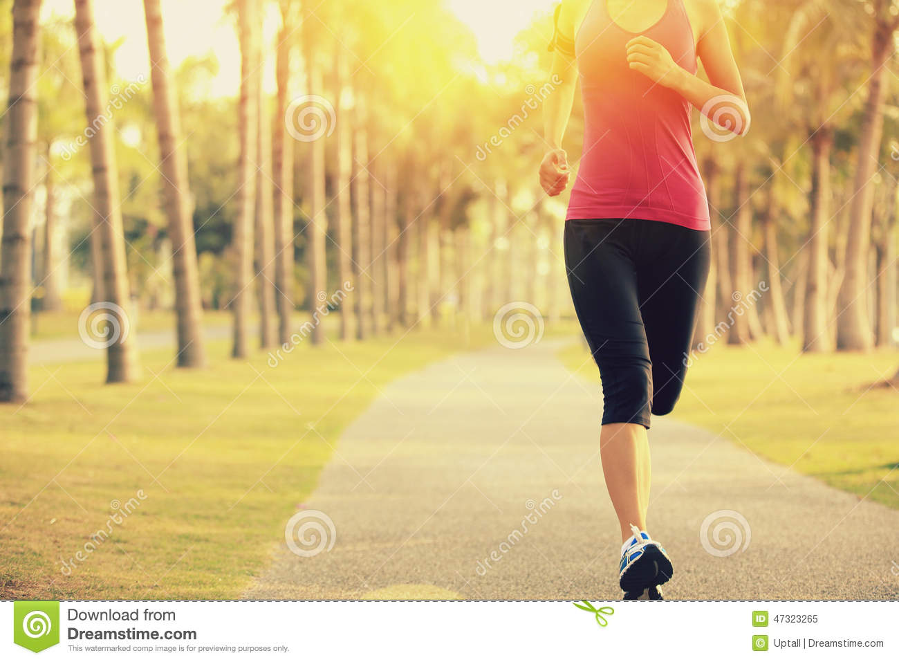 Runner athlete running at tropical park. woman fitness sunrise jogging workout