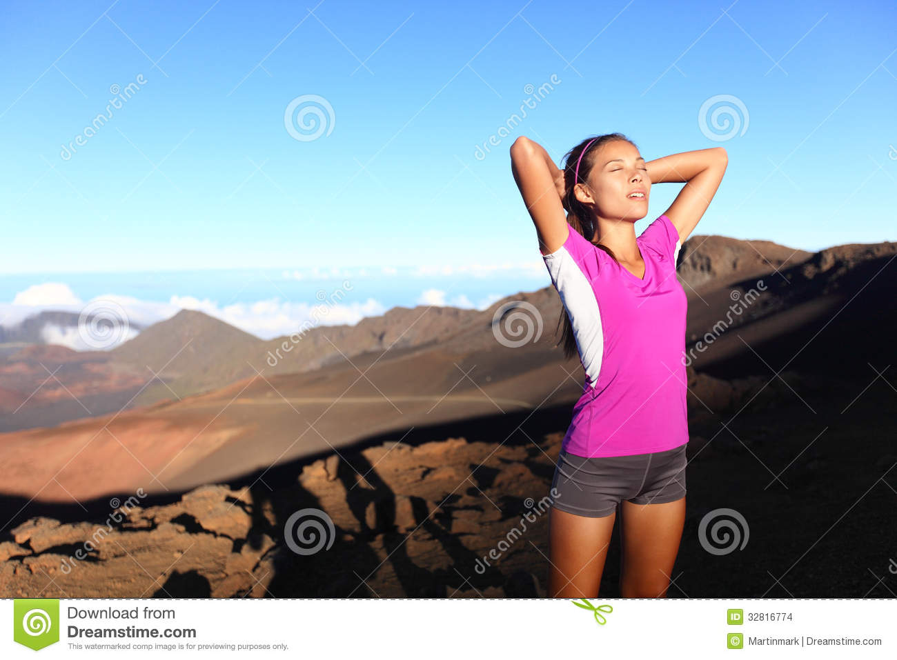 runner athlete woman relaxing after running stock images