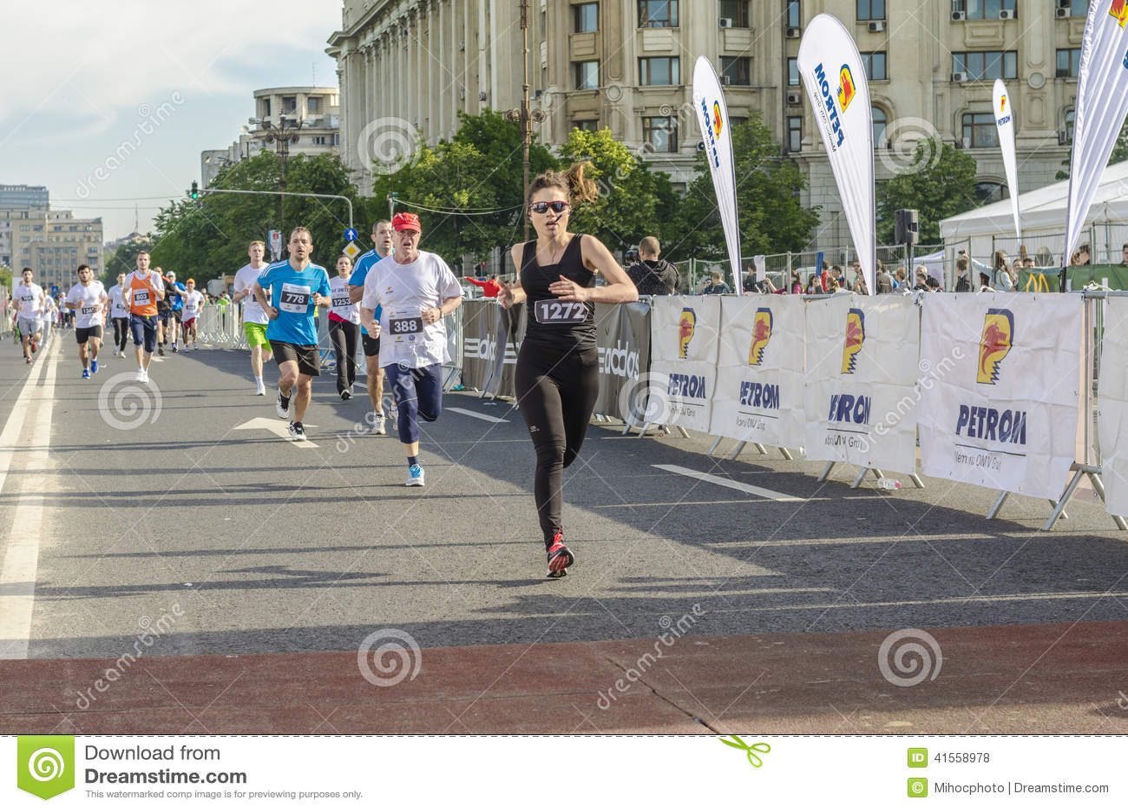 Runner female at finish line