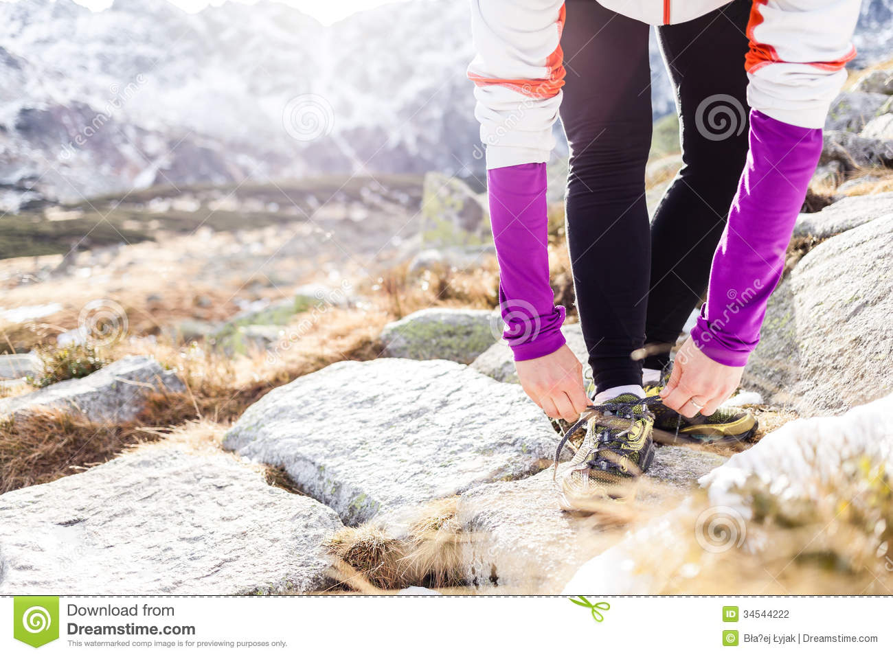 Young Woman Running In Mountains On Winter Fall Sunny Day ...