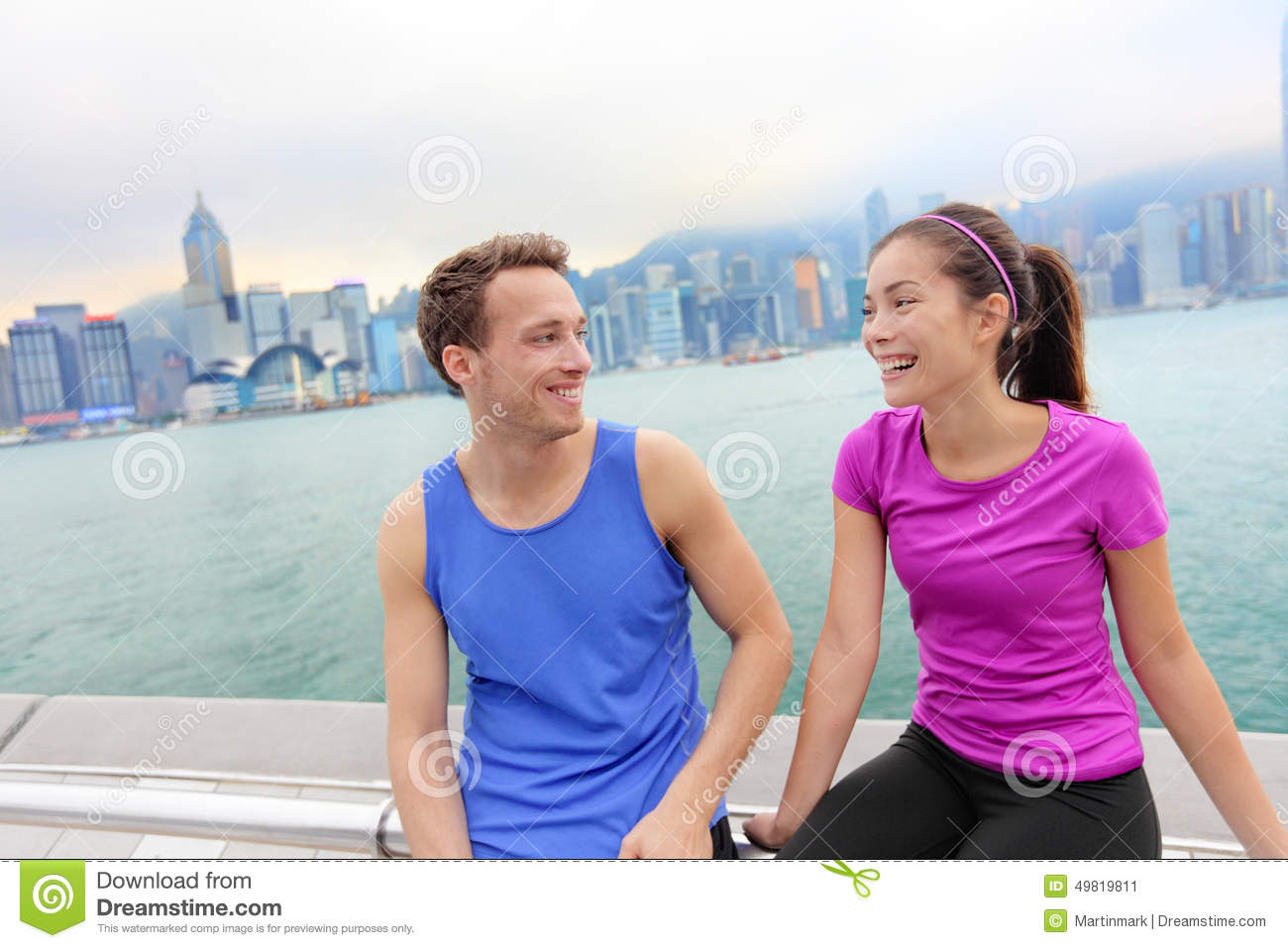 runners relaxing after workout in hong kong city stock