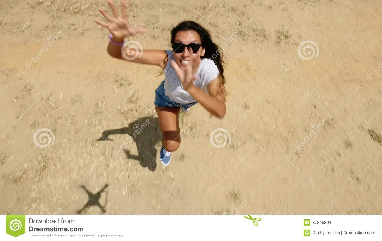 Running Angry Girl Trying To Catch Quadcopter Drone HD Aerial Shot From Above Stock Footage