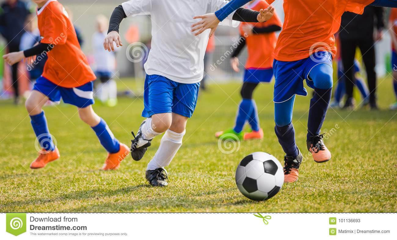 Running Children Football Soccer Players with Ball. Footballers kicking game
