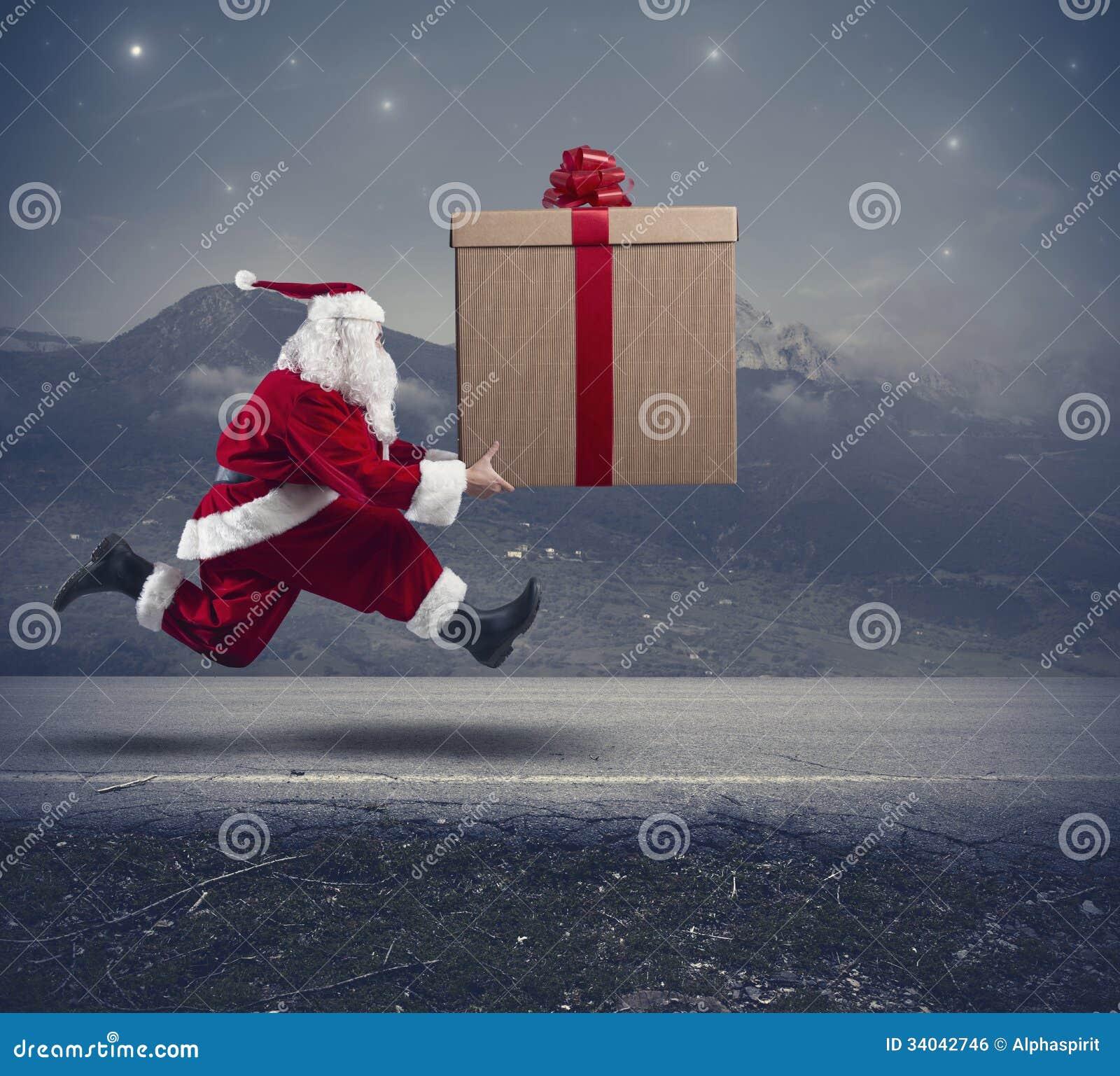 Running Santa Claus with big gift