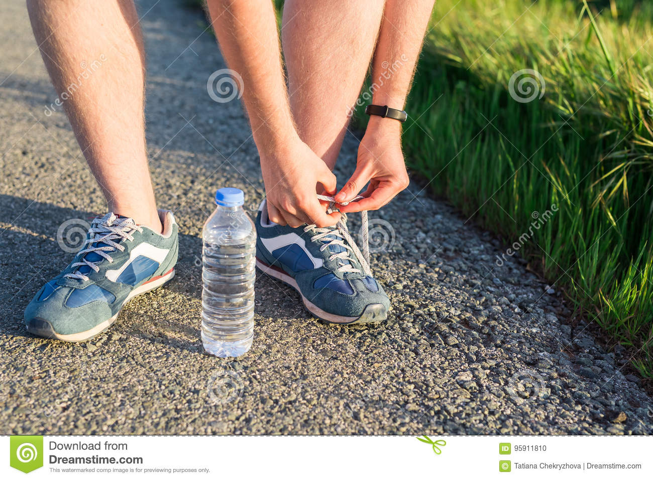 Running shoes. Barefoot running shoes close up. male athlete tying laces for jogging on road. Runner ties getting ready