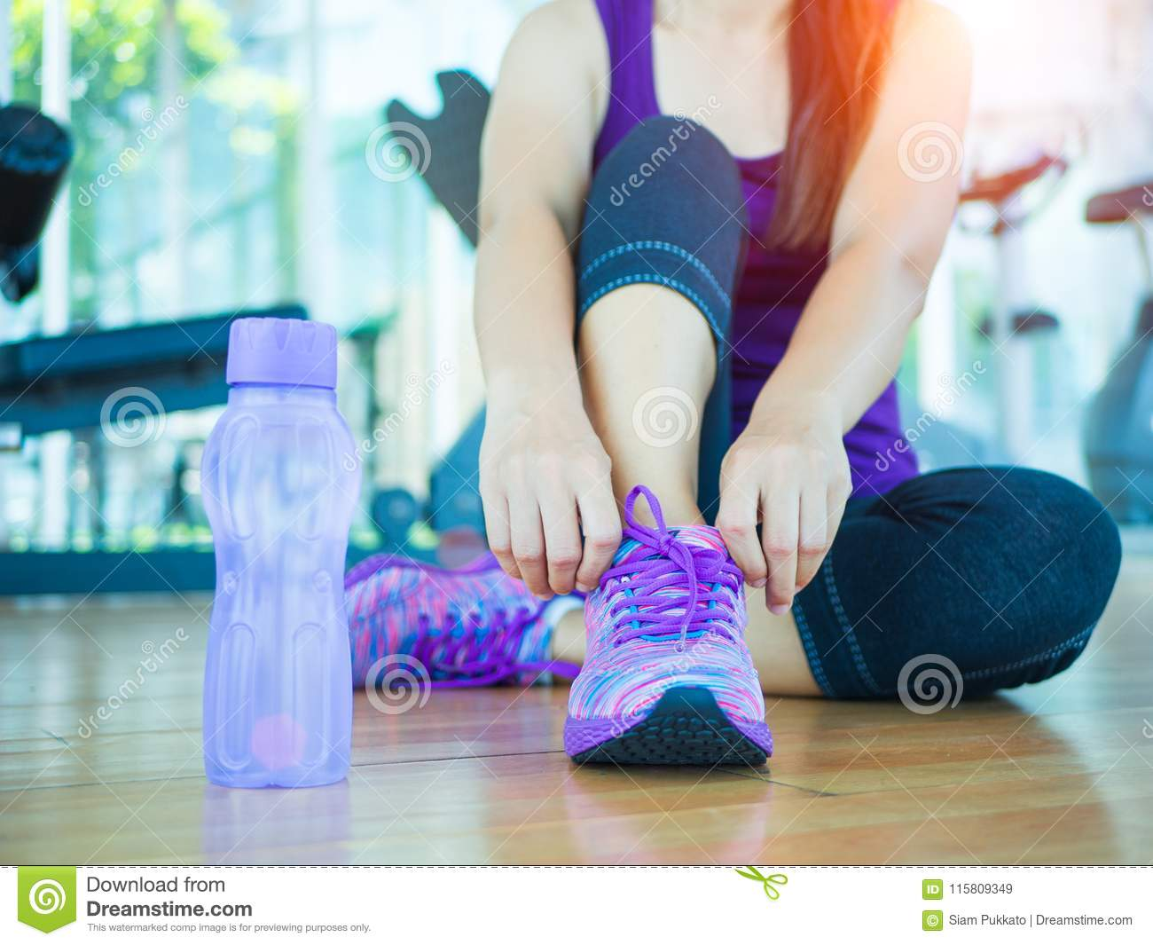 Closeup of woman tying shoe laces. Female sport fitness runner getting ready for jogging