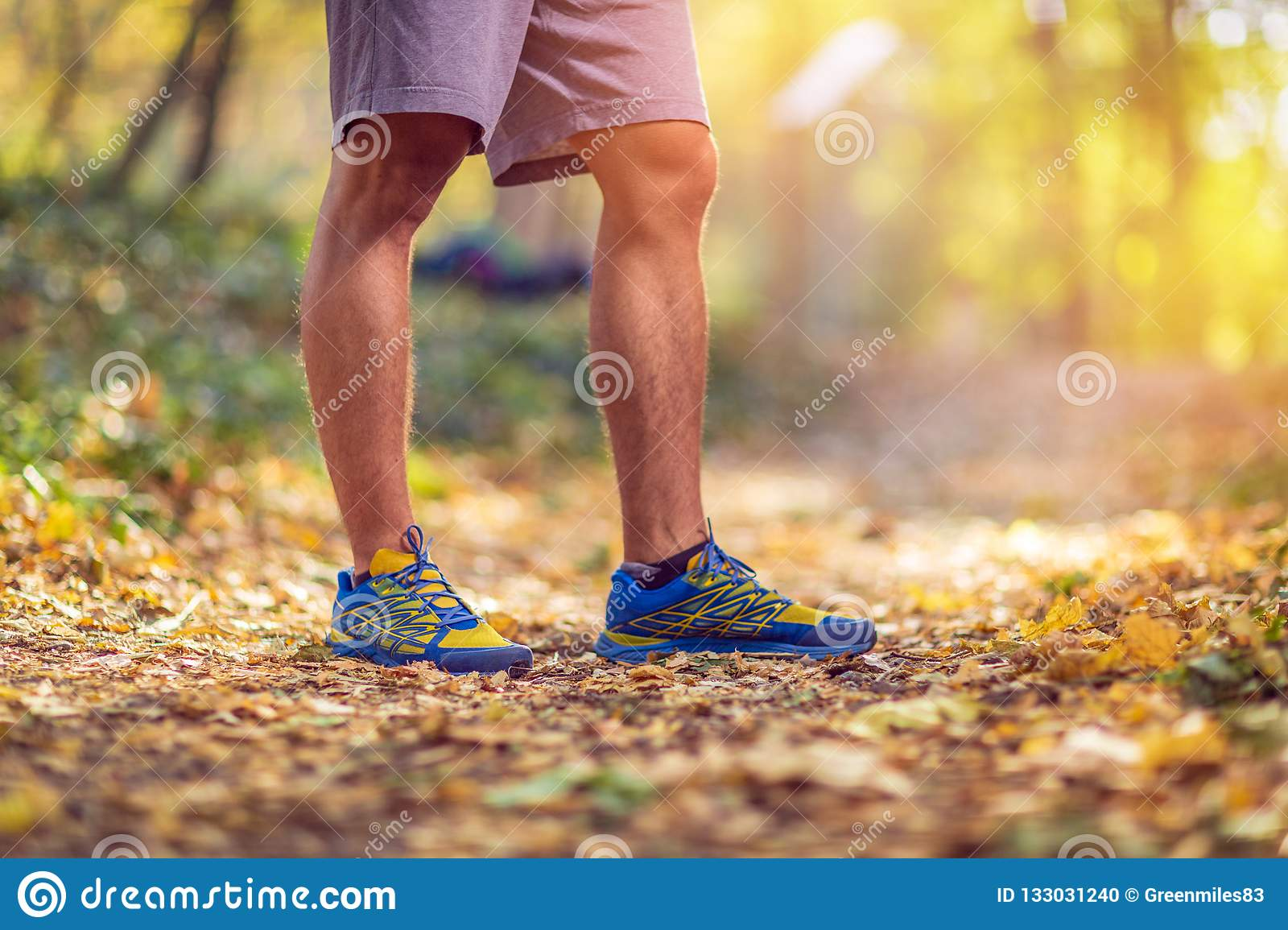 Running sport fitness man. Close up of male legs and shoes. Man