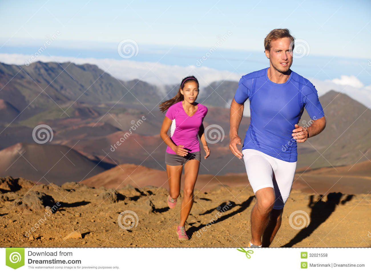 Running sport - trail runners in cross country run