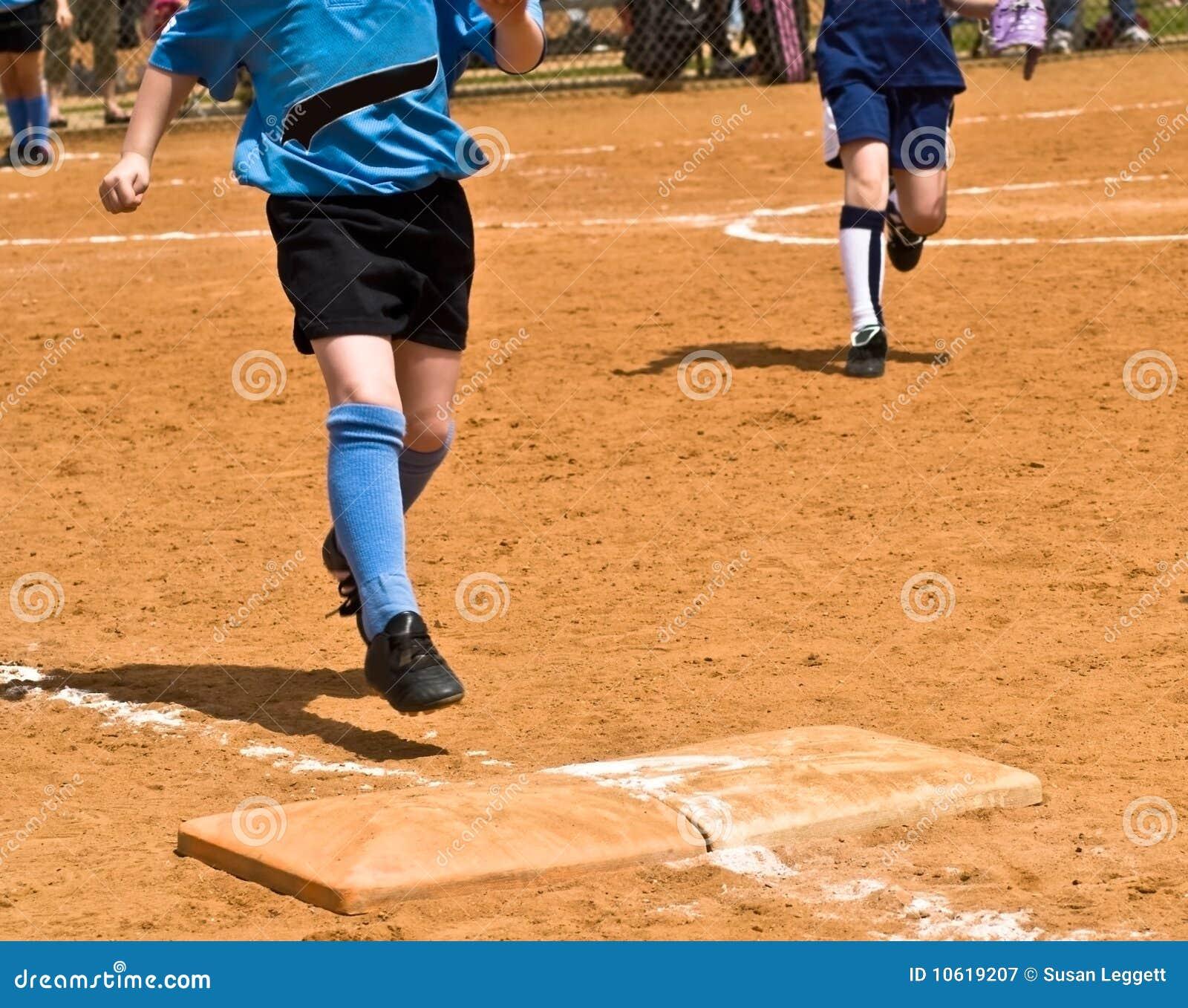 Girl runs the bases at baseball field 10