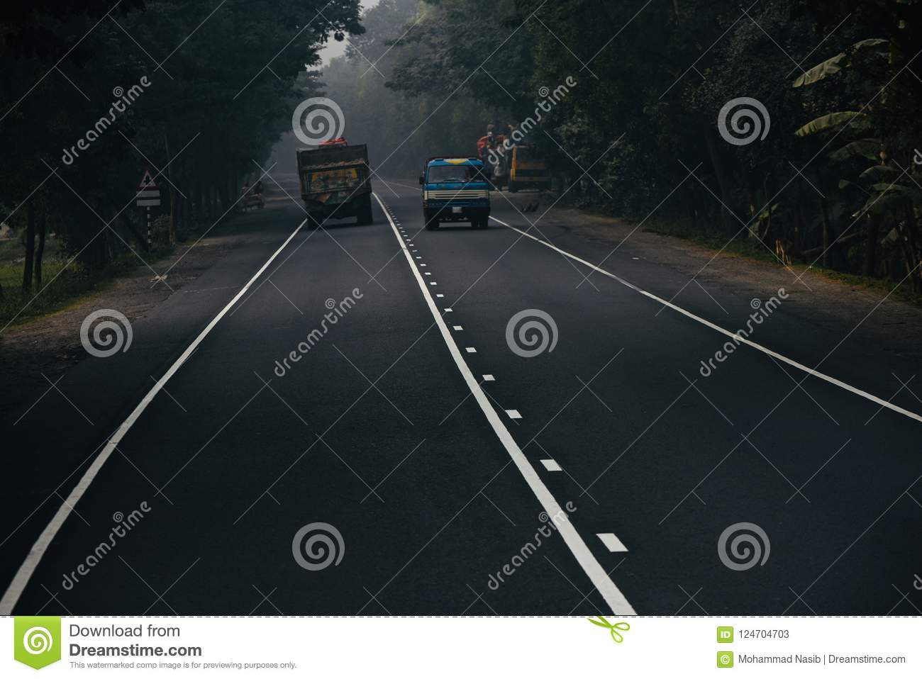 Download Running Trucks On The Street In Bangladesh In The Morning Stock Image - Image of abstract, photo: 124704703