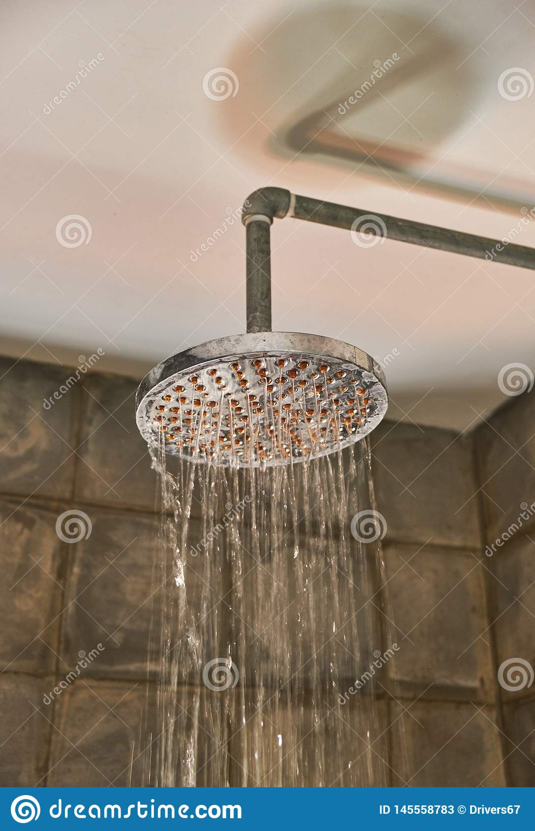 Shower in bathroom with water drops flowing
