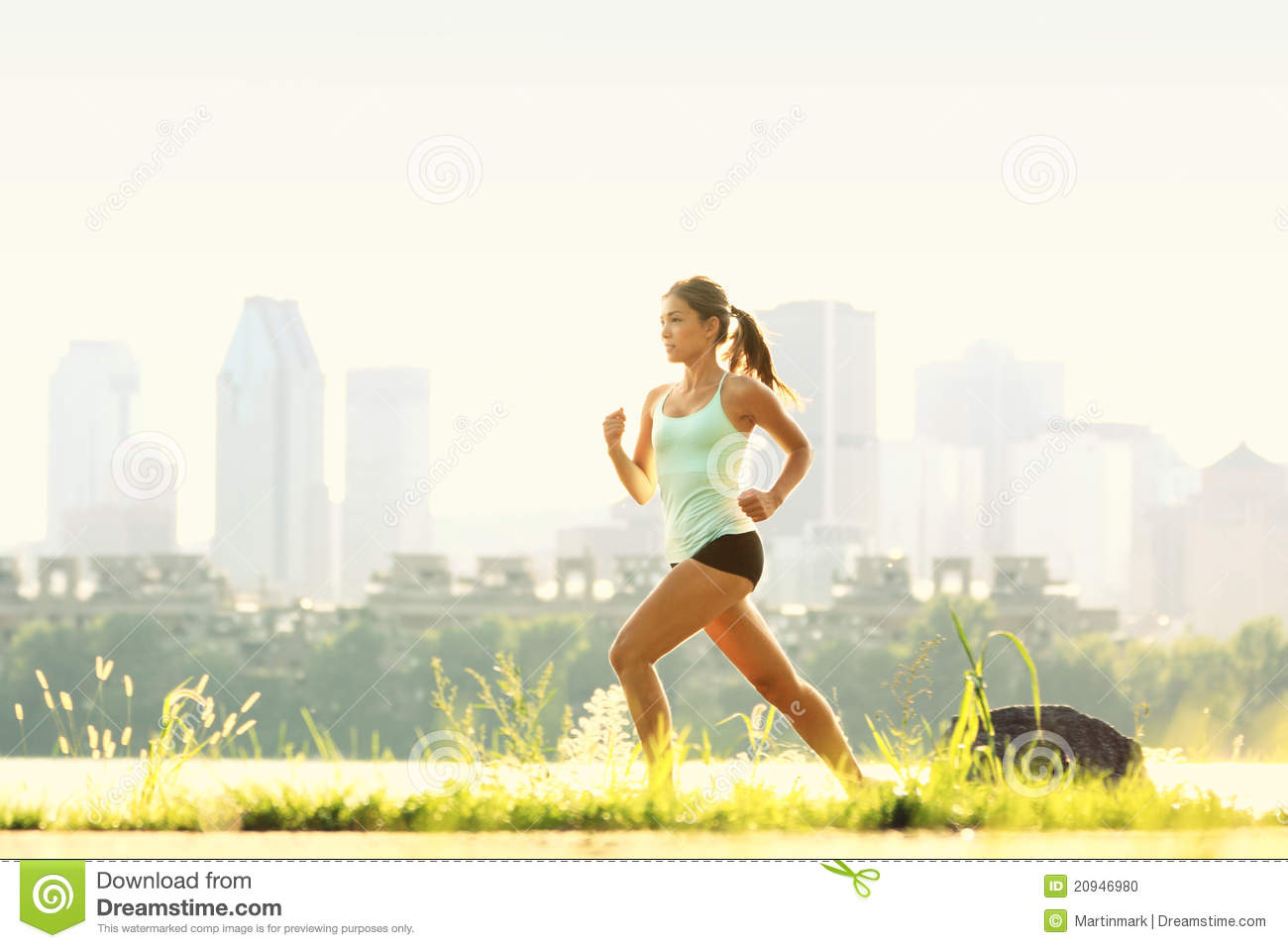Running woman in city park - outdoor fitness