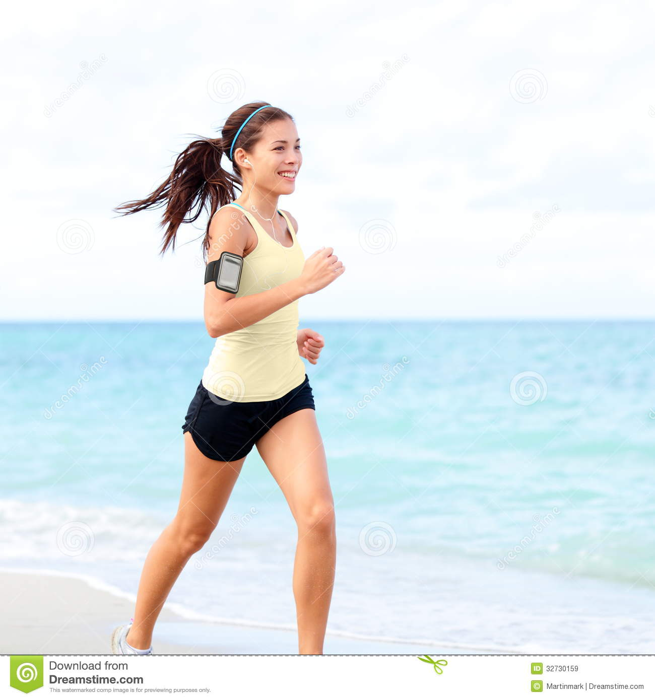Running woman jogging to music in new york city stock photo.