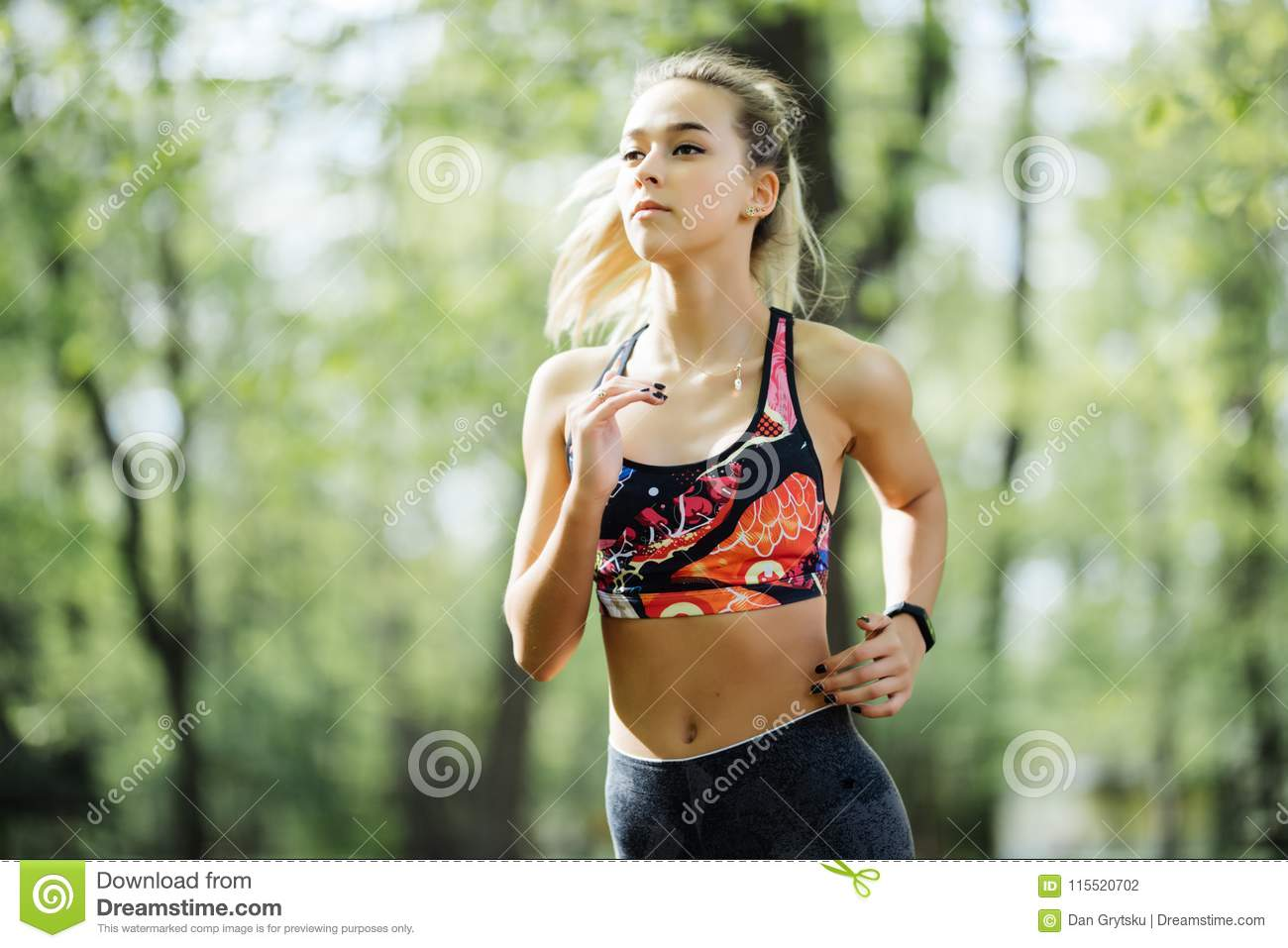50fbbf29d713 Running woman in park in summer training. Young sport fitness model in  sporty running clothes