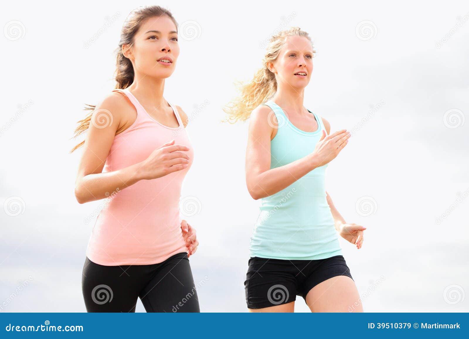 Running women jogging on beach