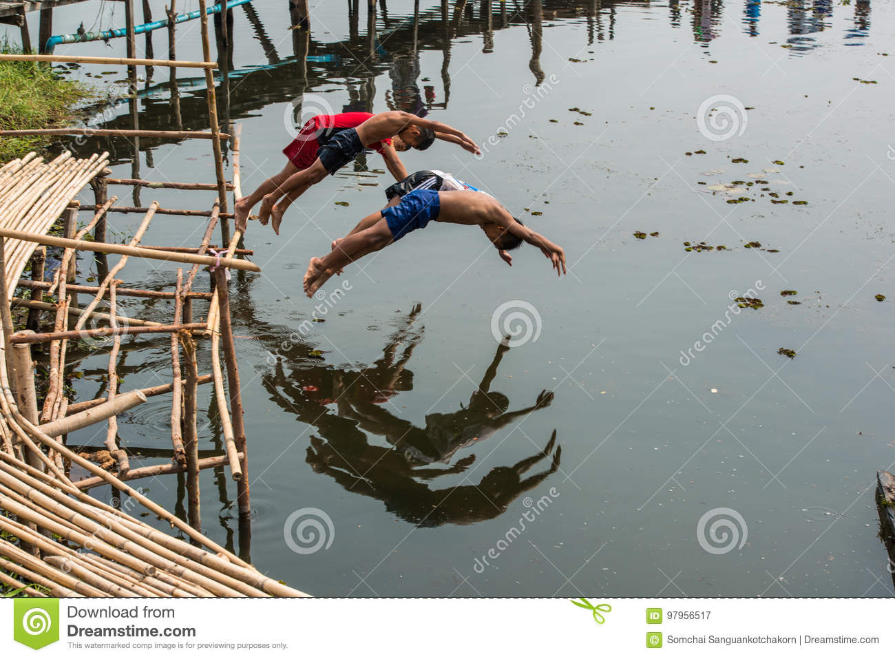 Rural children lifestyle in jumping into river