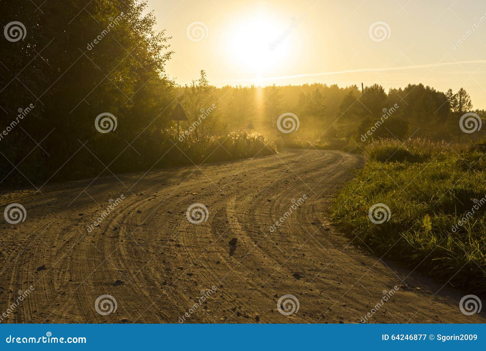 rural-dirt-road-sunset-dusty-64246877.jp