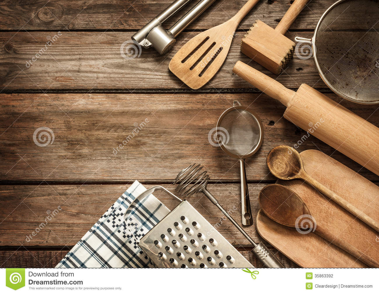 Rural kitchen utensils on vintage planked wood table stock for Table utensils