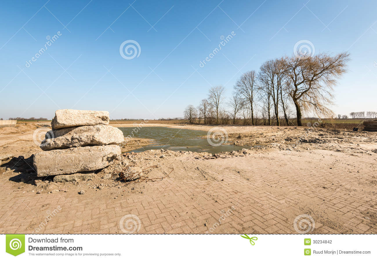 Demolition Concrete Poles : Stacked concrete culverts for water drainage stock photo