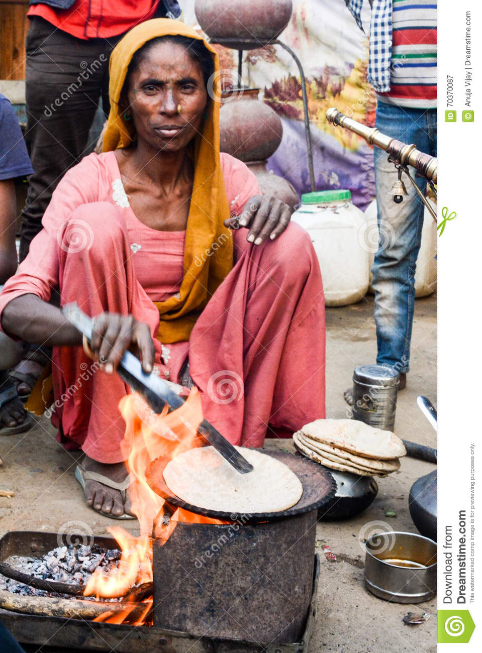 https://thumbs.dreamstime.com/z/rural-woman-cooking-chapati-indian-women-traditional-way-long-day-work-road-side-shelter-70370087.jpg Indian Woman Cooking