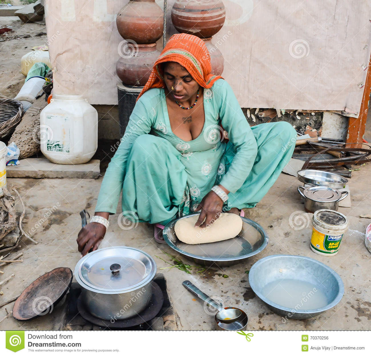 Rural Woman Cooking Chapati Editorial Photo - Image: 70370256