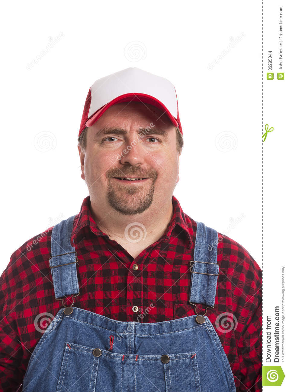 523fd8b51b A man wearing a red and black flannel shirt with bib overalls and a hat  with a white front.