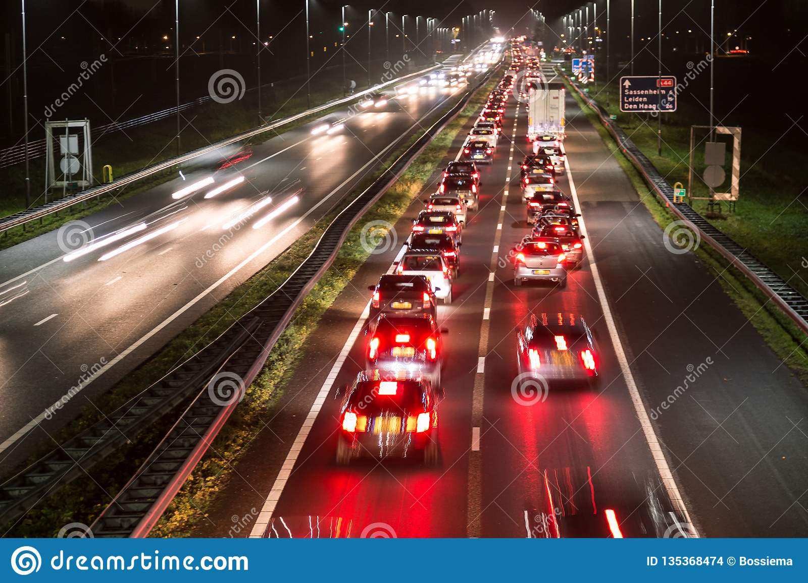 Busy highway traffic with light trails