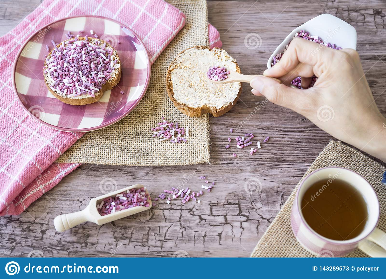 Flat Lay With Rusk, Sweet Pink Purple Sprinkles And Cup Of