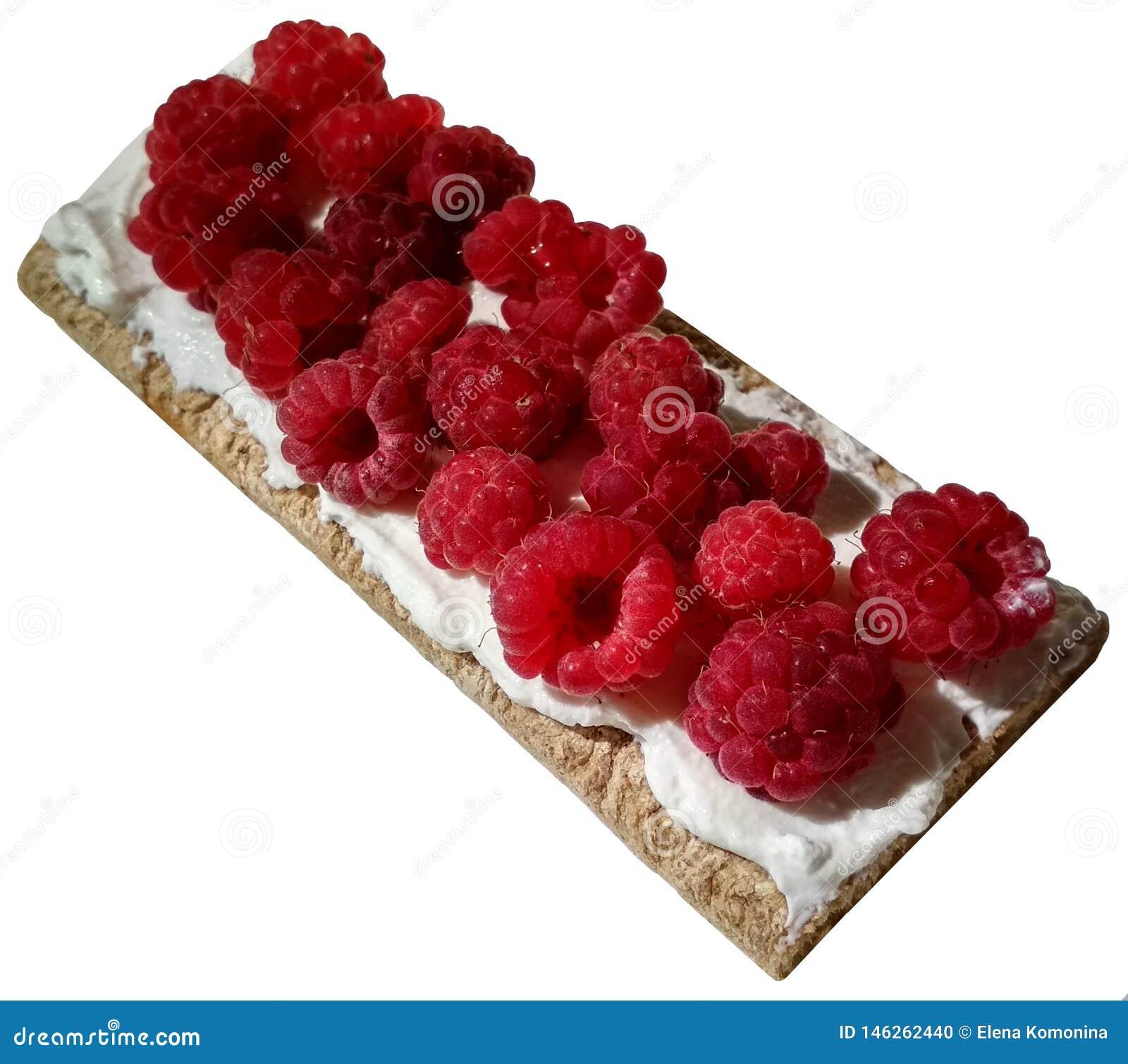 Ruspberries σε ένα pieace του τριζάτου ψωμιού με την κρέμα