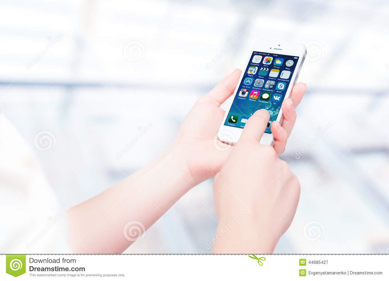 Russia, Chelyabinsk, September 8, 2014. Person holding a new white Apple iPhone 5S, smartphone in part of the iPhone line. Develo