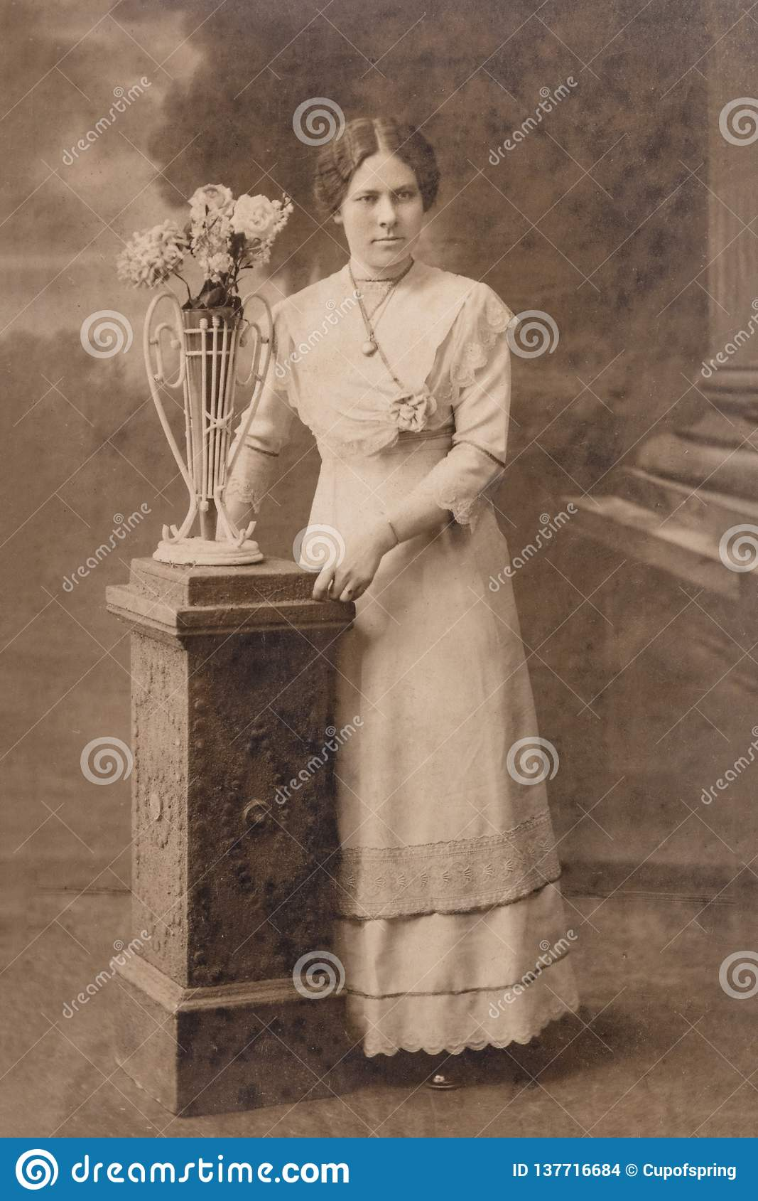 RUSSIA - CIRCA 1905-1910: A portrait of young woman in studio, Vintage Carte de Viste Edwardian era photo
