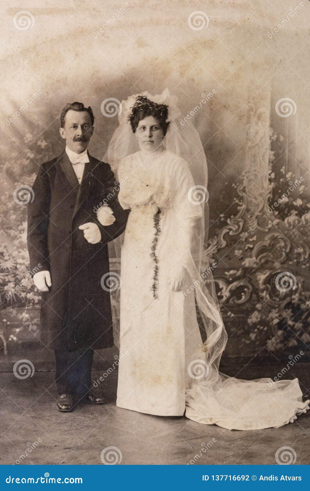RUSSIA - CIRCA 1905-1910: Wedding shot of just married couple in studio, Vintage Carte de Viste Edwardian era photo