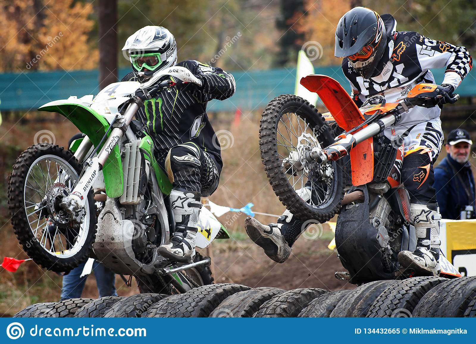 Russia, city of Magnitogorsk, - July, 10, 2011. Participants races motocross competition at an open city stadium