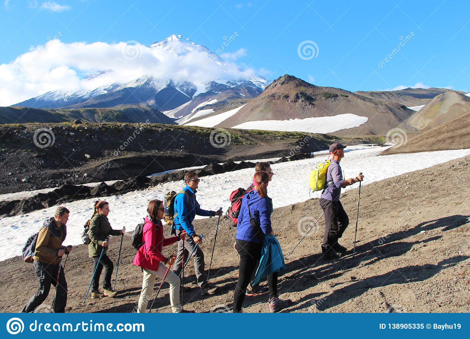 Hikers are on the route to volcano