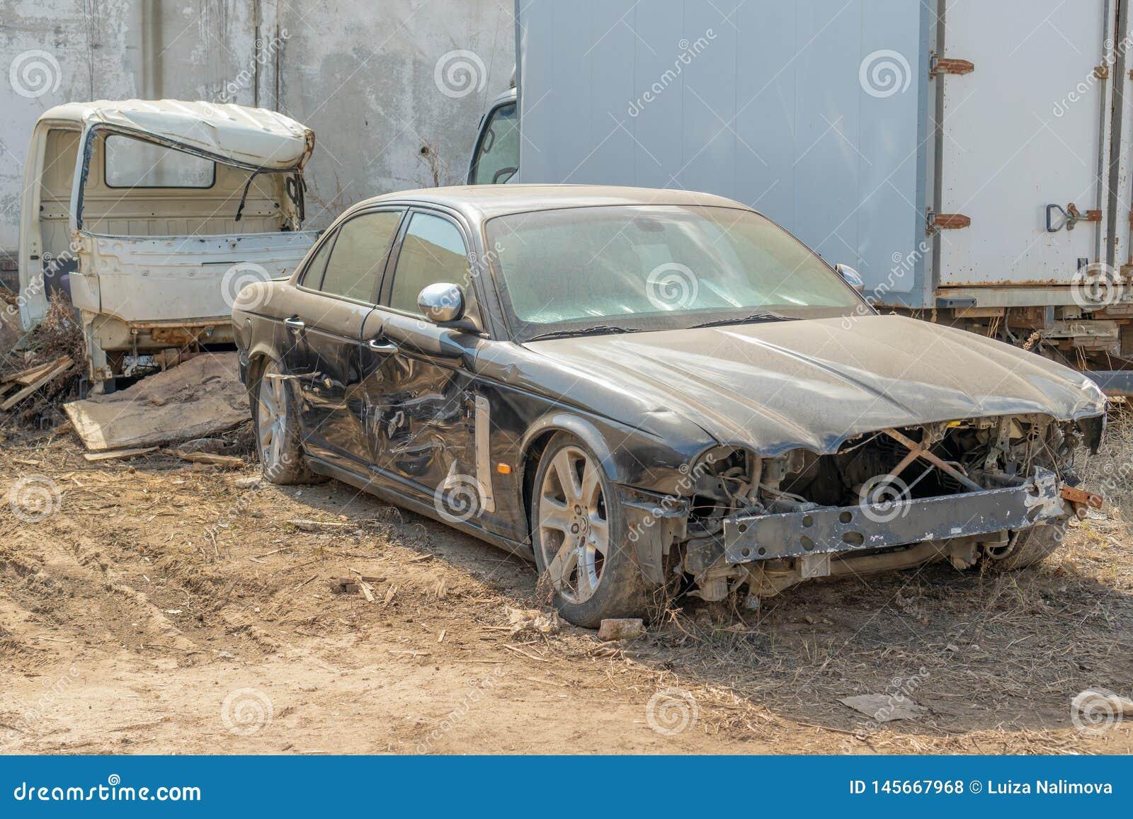 Russia, Kazan - April 20, 2019: Abandoned black Jaguar.