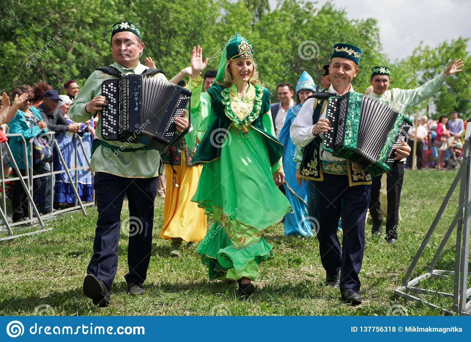 Russia, Magnitogorsk, - June, 23, 2018. Street parade in traditional costumes during Sabantuy - the national holiday of the plow.