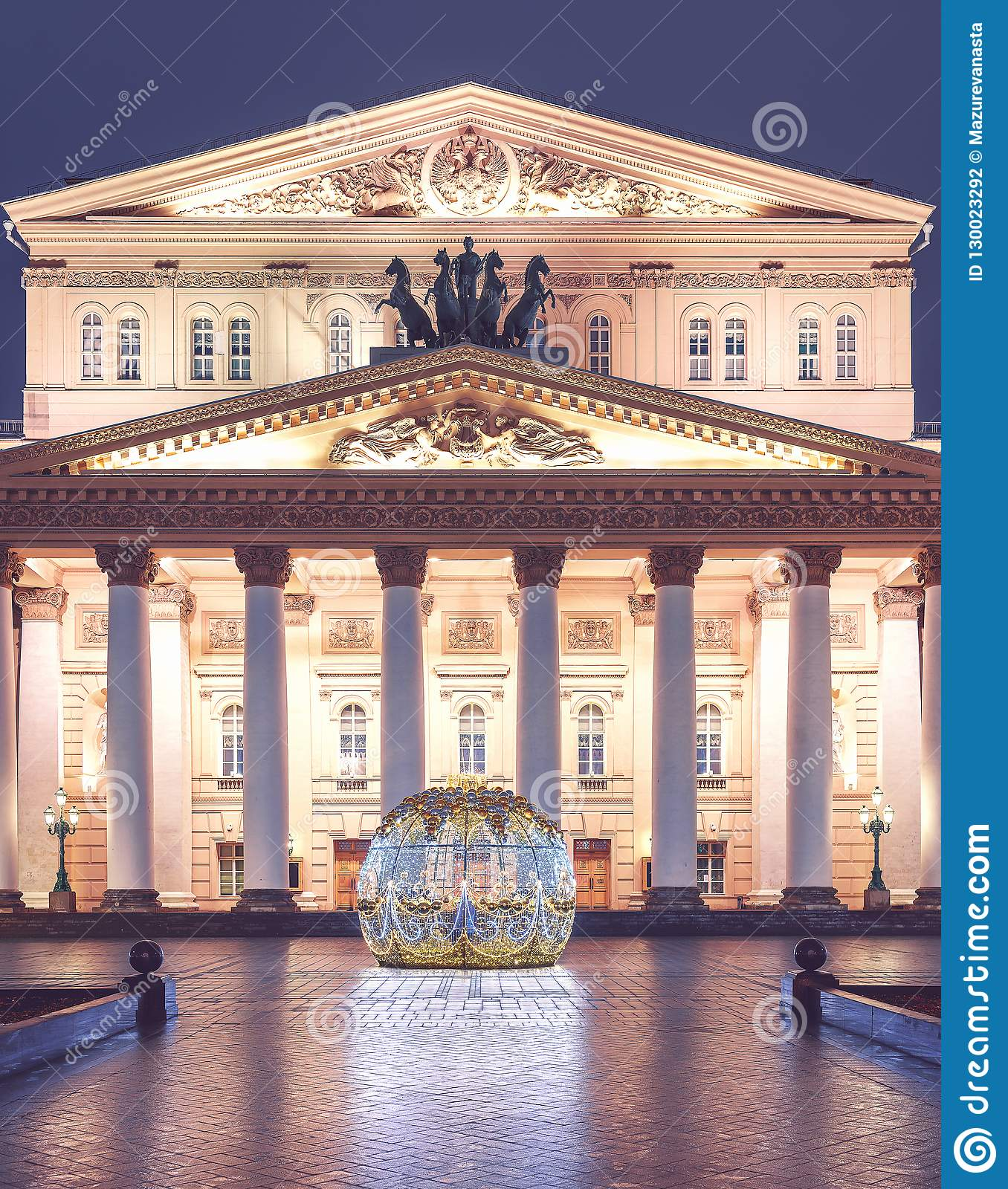 Uminous Christmas ball in front of the Bolshoi Theatre on Theatre Square. Moscow seasons. Winter. New Year`s scenery.