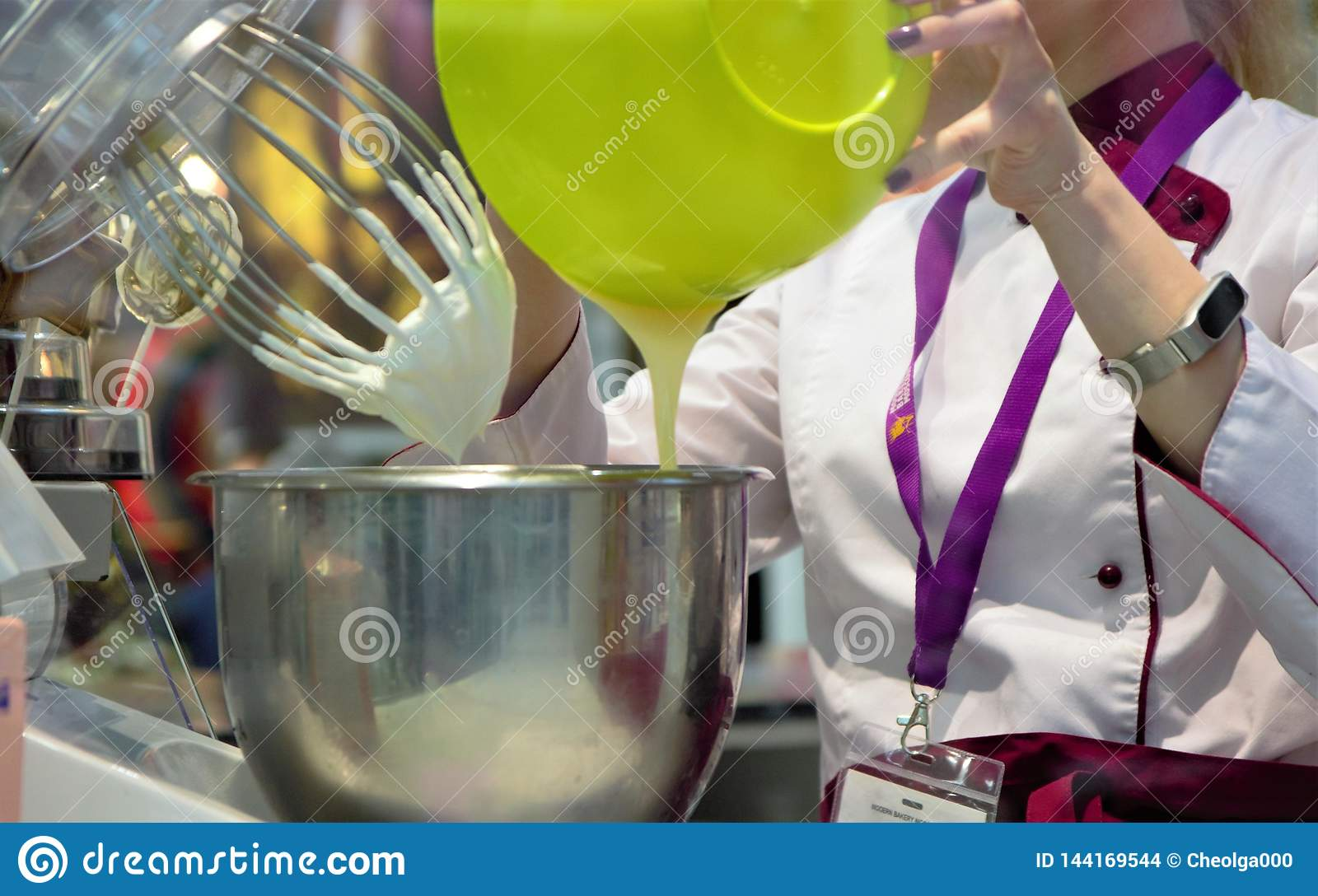 03.14.2019 Russia, Moscow. Exhibition Modern Bakery Moscow. A confectioner kneads a cream using a production machine.